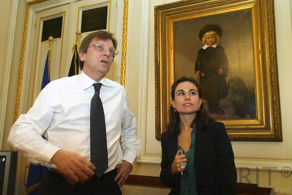 BRUSSELS - BELGIUM - 23 OCTOBER 2006 -- Guy VERHOFSTADT, Prime Minister of Belgium together with El Mundo journalist Maria RAMIREZ in his office.   PHOTO: ERIK LUNTANG /