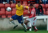 Photo: Henry Browne.<br /> Swindon v Nottingham Forest. Coca Cola League 1.<br /> 13/08/2005.<br /> Scott Dobie of Forest holds off Jerel Ifil of Swindon.