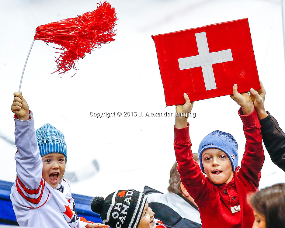 Young Team Switzerland fans show their team spirit during the 2015 IIHF Junior World Championships.