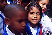 MARCH 19, 2001 - HAVANA, CUBA:  Elementary school students in the historic section of Havana, Cuba, March 19, 2001. Despite problems in its economy,  Cuba's educational system remains strong and is considered a role model for many developing countries. Cuba has virtually eliminated illiteracy.   PHOTO by  JACK KURTZ       WOMEN   EDUCATION  FAMILY  CHILDREN