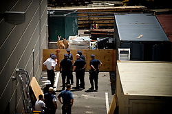 New York, NY: Thu, Jul 01, 2010:  NYPD officers contain 2 wayward deer in the parking lot of a Target department store located in a highly urban section of the Bronx. The duo are believed to have traveled a long way south and into the city by following commuter train tracks..