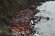 Nov. 23, 2015 - Lesbos, Greece - <br /> <br /> Volunteers help to clean the beach in Lesbos<br /> <br /> lifejackets and inflatable boats near the lighthouse in Lesbos island on 23 November 2015. <br /> ©Tasos Markou/Exclusivepix Media