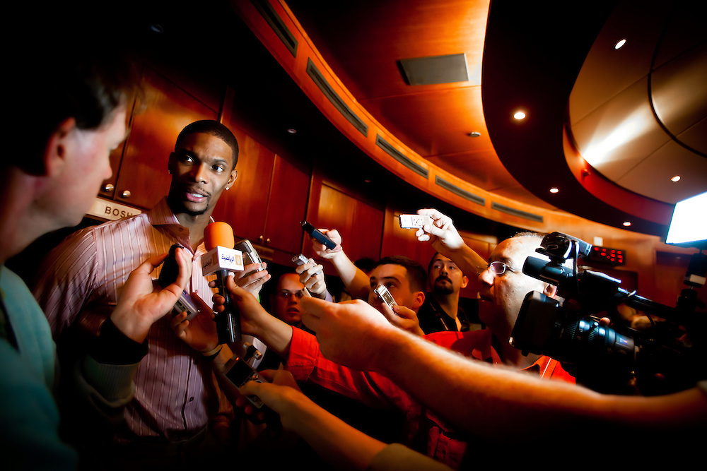 MIAMI, FL -- January 29, 2012 -- Miami forward Chris Bosh speaks with the media in the locker room after the Heat's 97-93 win over the Chicago Bulls at American Airlines Arena in Miami, Fla., on Sunday, January 29, 2012.  (Chip Litherland for ESPN the Magazine)