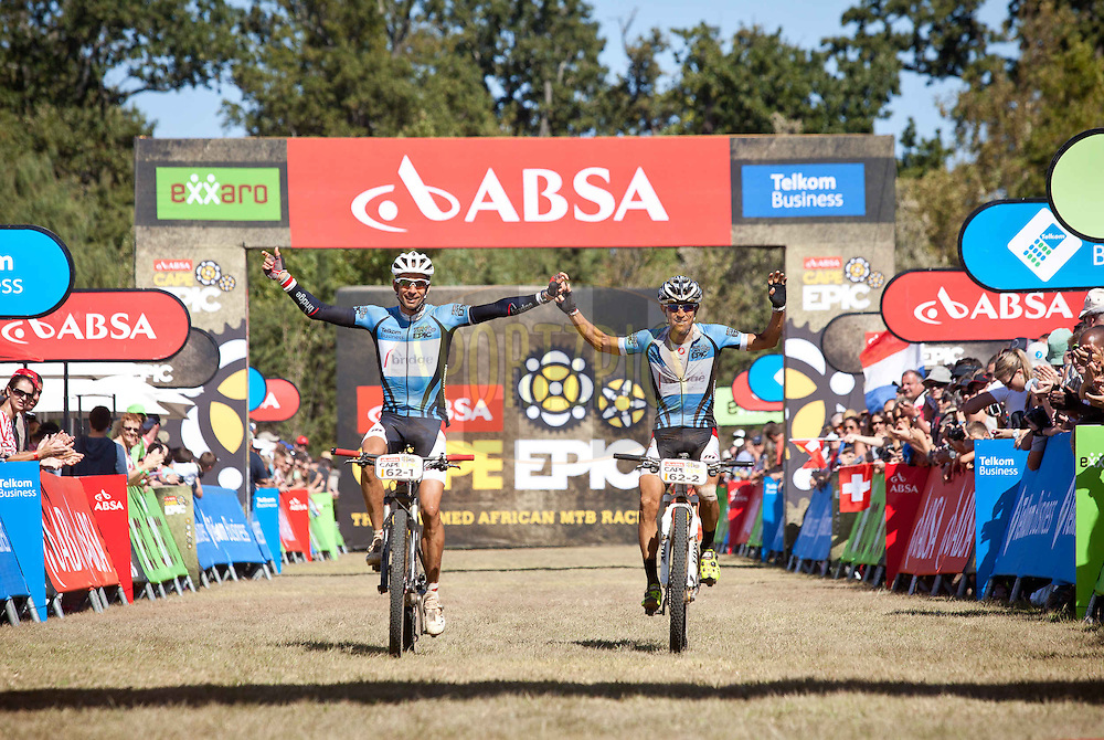 Masters Winners Nico Pfitzenmaier(L) and Abraao Azevedo(R) cross the line of the final stage (stage 7) of the 2013 Absa Cape Epic Mountain Bike stage race from Stellenbosch to Lourensford Wine Estate in Somerset West, South Africa on the 24 March 2013..Photo by Sam Clark/Cape Epic/SPORTZPICS