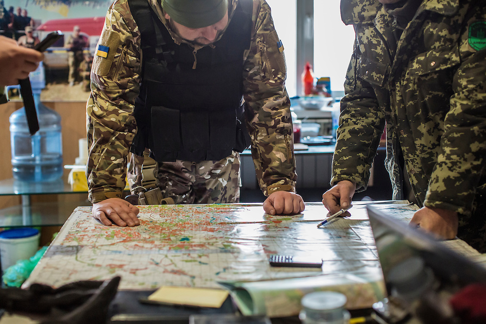 KRASNOARMIISK, UKRAINE - NOVEMBER 17, 2014: Members of the Dnipro-1 brigade, a pro-Ukraine militia, review maps at their base in Krasnoarmiisk, Ukraine. CREDIT: Brendan Hoffman for The New York Times
