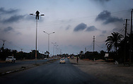 On the road back to Misrata from AL Dafniyah frontline, an effigy hangs atop a light pole as a grim warning to Gadhafi's loyalists. 30 May 2011.