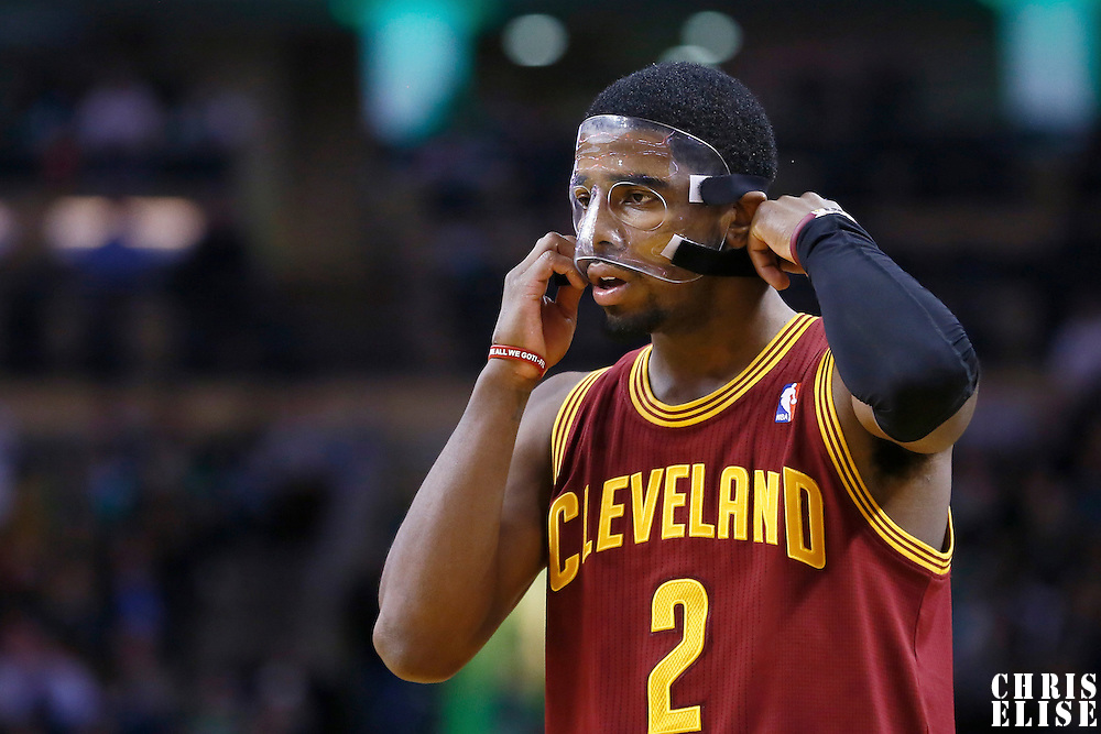 19 December 2012: Cleveland Cavaliers point guard Kyrie Irving (2) puts on his protective mask during the Boston Celtics 103-91 victory over the Cleveland Cavaliers at the TD Garden, Boston, Massachusetts, USA.