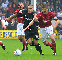 Photo: Dave Linney.<br />Walsall v Milton Keynes Dons. Coca Cola League 1.<br />08/10/2005. Arm in arm. Joe Broad(Walsall) trys to stay in front of Paul Mitchell(MK Dons)