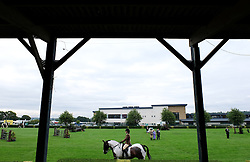 © Licensed to London News Pictures.14/07/15<br /> Harrogate, UK. <br /> <br /> A rider and her horse ride around the arena during their event on the opening day of the Great Yorkshire Show.  <br /> <br /> England's premier agricultural show opened it's gates today for the start of three days of showcasing the best in British farming and the countryside.<br /> <br /> The event, which attracts over 130,000 visitors each year displays the cream of the country's livestock and offers numerous displays and events giving the chance for visitors to see many different countryside activities.<br /> <br /> Photo credit : Ian Forsyth/LNP