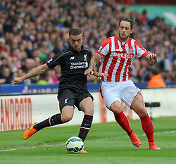 Liverpool's Jordan Henderson and Stoke City's Marko Arnautovic jostle for the ball - Photo mandatory by-line: Nizaam Jones/JMP - Mobile: 07966 386802 - 24/05/2015 - SPORT - Football - Stoke - Britannia Stadium - Stoke City v Liverpool - Barclays Premier League