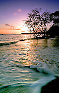Waves water and sunset from beach on Maui Hawai