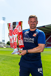 (Free to use courtesy of Sky Bet) Manager Richie Wellens lifts the trophy as Swindon Town gather at The County Ground to celebrate becoming Sky Bet League Two Champions, with a socially distanced trophy lift, after the curtailment of the regular season due to the Covid-19 pandemic - Rogan/JMP - 26/06/2020 - The County Ground - Swindon, England - Sky Bet League 2.