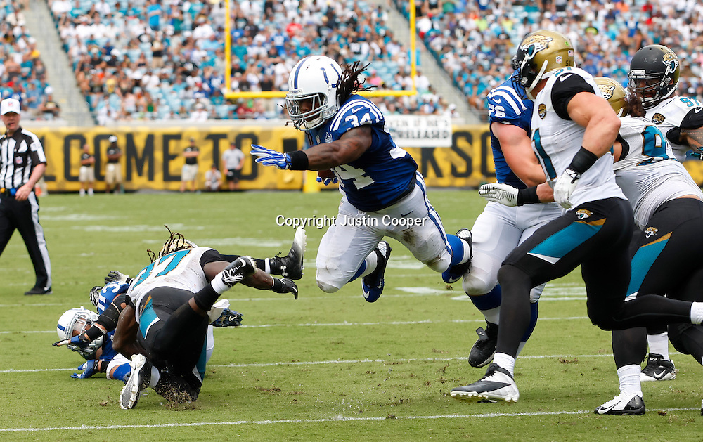 September 29, 2013:  Indianapolis Colts running back #34 Trent Richardson jumps to the outside during the Jacksonville Jaguars 3 to 37 loss to the Indianapolis Colts at Everbank Field in Jacksonville, FL.
