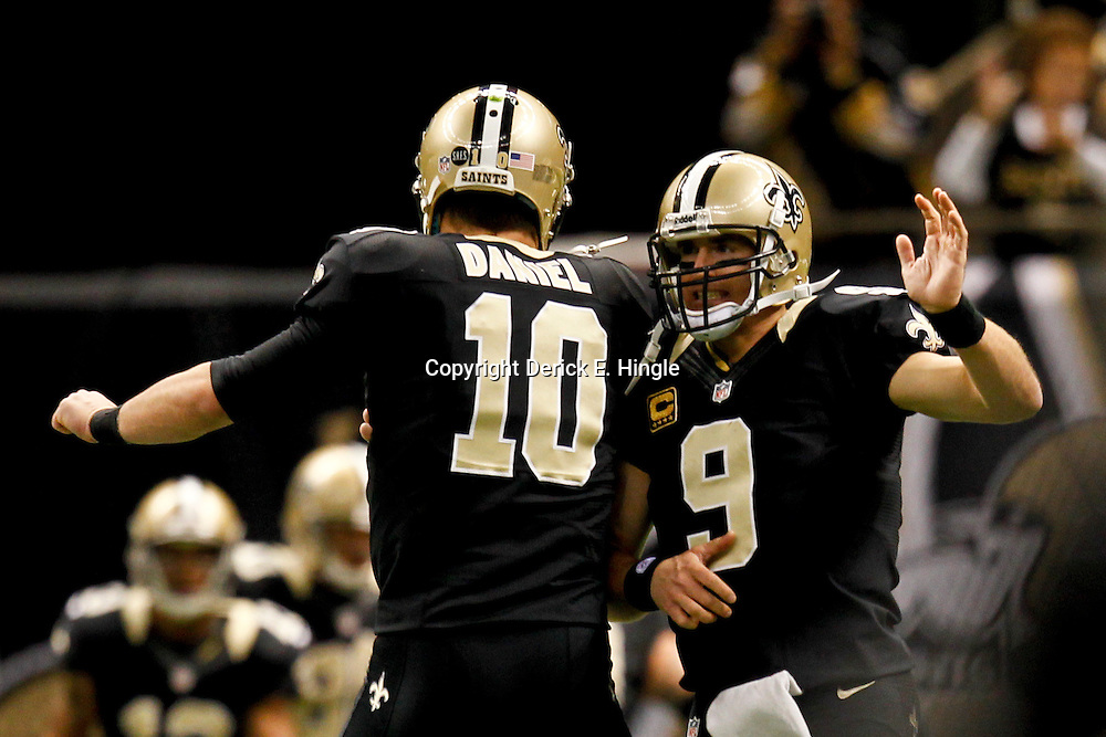 December 30, 2012; New Orleans, LA, USA; New Orleans Saints quarterback Drew Brees (9) celebrates with quarterback Chase Daniel (10) after a touchdown pass against the Carolina Panthers during the second half of a game at the Mercedes-Benz Superdome. The Panthers defeated the Saints 44-38. Mandatory Credit: Derick E. Hingle-USA TODAY Sports