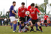 City of Liverpool's (purple) Jamie McDonald and  and   Litherland's Chris Lowe (Red) during the North West Counties League Play Off Final match between Litherland REMYCA and City of Liverpool FC at Litherland Sports Park, Litherland, United Kingdom on 13 May 2017. Photo by Craig Galloway.