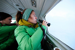 NORWAY BARENTS SEA 6DEC15 - Greenpeace campaigners Larissa Baeumer of Germany and Erlend Tellnes (L) of Norway during the survey flight to the production platform Goliat in the Barents Sea operated by Italian energy compay Eni. It is the world's most northerly oil production platform.<br /> <br /> jre/Photo by Jiri Rezac / Greenpeace<br /> <br /> © Jiri Rezac 2015