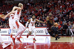 10 January 2018:  Aundre Jackson tripled by Keyshawn Evans, Phil Fayne and Taylor Bruninga during a College mens basketball game between the Loyola Chicago Ramblers and Illinois State Redbirds in Redbird Arena, Normal IL