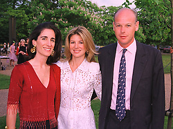 Left to right, PRINCESS KARL VON AUERSPERG-BREUNNER and the HON. & MRS CHARLES HAMBRO, at a party in London on 7th July 1999.MUC 45