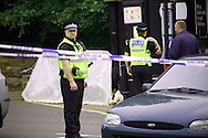 Officers at the scene of a death in a car park off Sheep Street in Kettering, 18/07/08
