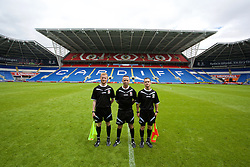 CARDIFF, WALES - Friday, June 5, 2015: Referee Dean John and his assistants Ian Bird and Dan Pearce after a practice match at the Cardiff City Stadium ahead of the UEFA Euro 2016 Qualifying Round Group B match against Belgium. (Pic by David Rawcliffe/Propaganda)