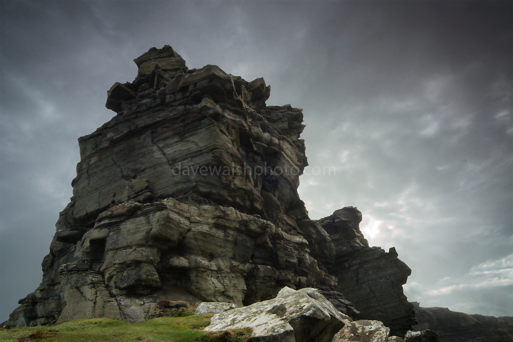 Hag's Head, at the Cliffs of Moher, Clare, Ireland, 200m high cliffs on the Atlantic coast. This photograph was taken below the cliff top, from the sea looking in, towards land. The only manipulation in this image is to separate the exposure of the sky from that of the rocks. ..