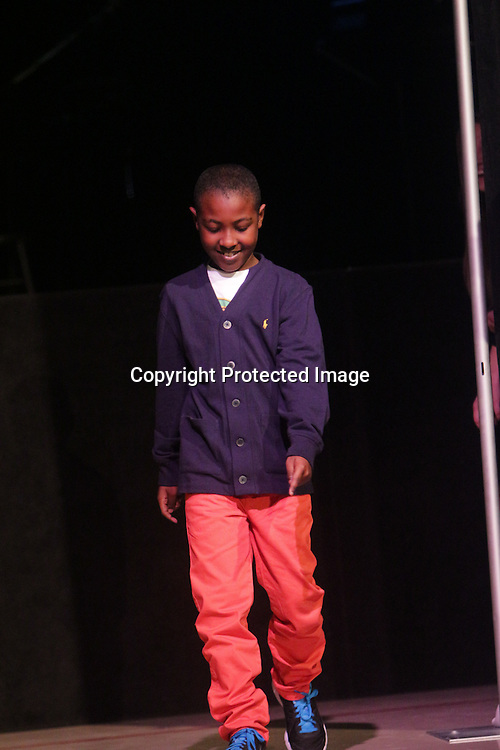Tye Hunt walks the runway during the I Am Beautiful fashion show to benefit the Miracle League of Wilmington. (Jason A. Frizzelle)