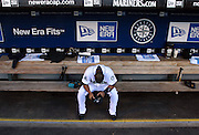 Seattle Mariners second baseman Jose Lopez takes a moment to himself in the dug out Tuesday, July 31, 2007, before the start of  game against the Los Angeles Angels at Safeco Field in Seattle, Wash.