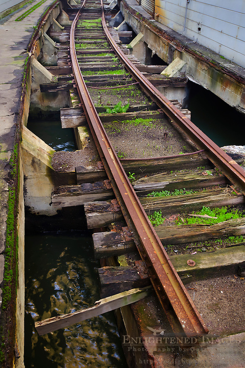 Old rusted railroad tracks on pier along the San Francisco Bay waterfront in San Francisco, California
