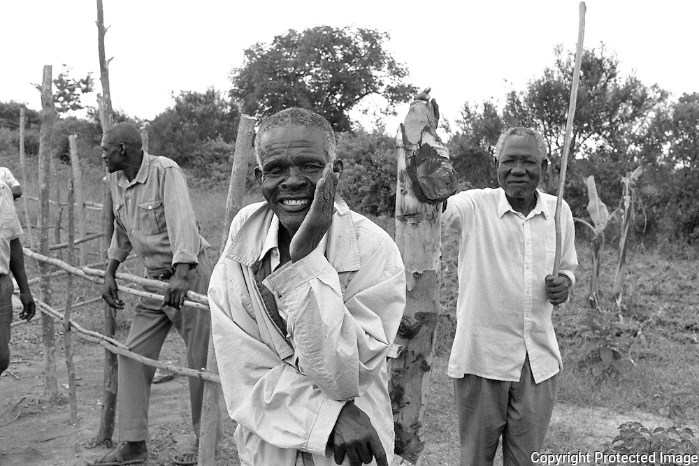 Village elders, mostly male, play and important role in village life in Nyanza Province, Kenya. Workers from CARE Kenya discussed new and old projects with these men at an informal meeting.