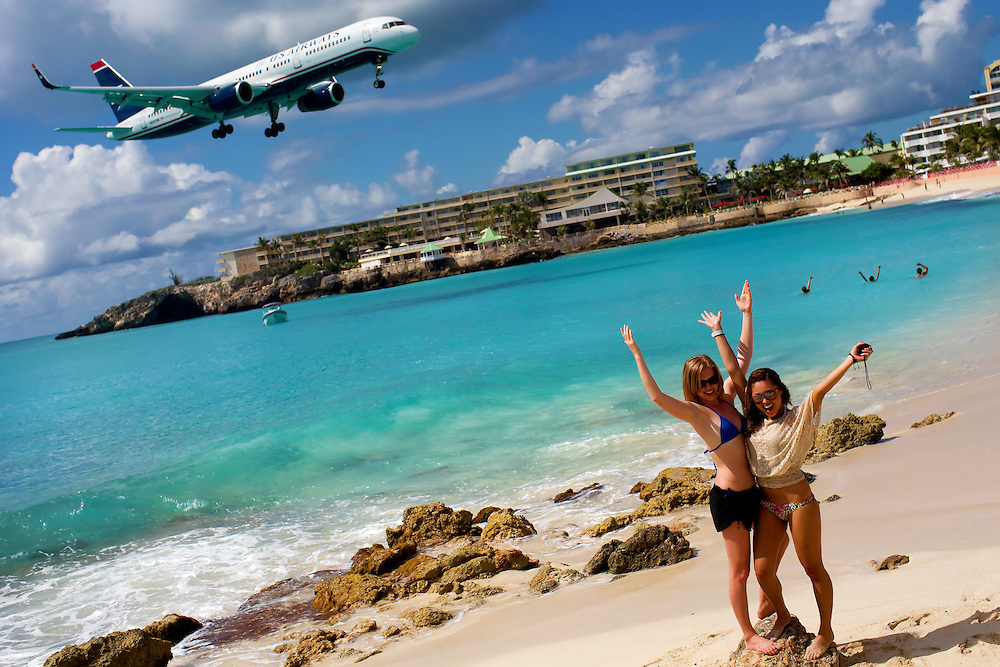St. Martin St. Maarten -- February 2011 -- Sunbathers watch an U.S. Airways plane land over Maho Beach at Sunset Bar & Grill near Princess Juliana Airport on the Caribbean island of St. Martin / St. Maarten, which is split between France and the Netherlands.  (Photo by Chip Litherland)