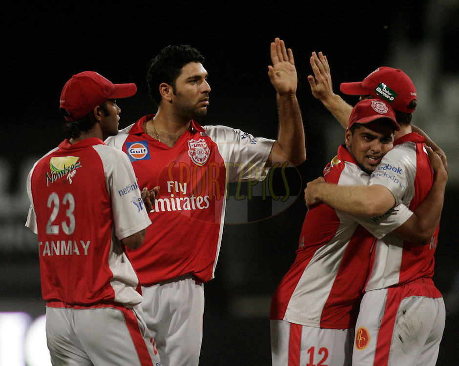 DURBAN, SOUTH AFRICA - 1 May 2009. Tanmay Srivastava, Yuvraj Singh, Yusuf Abdulla and Simon Katich celebrate a wicket during the IPL Season 2 match between Kings X1 Punjab and the Royal Challengers Bangalore held at Sahara Stadium Kingsmead, Durban, South Africa..