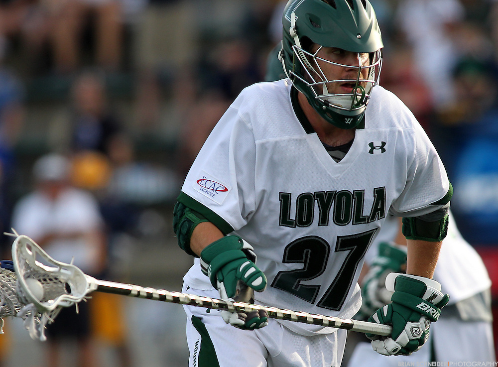 May 12, 2012; Baltimore, MD, USA; Loyola Maryland Greyhounds Reid Acton (27) against the Canisius College Golden Griffins at Ridley Athletic Complex in Baltimore, MD. Mandatory Credit: Brian Schneider-www.ebrianschneider.com