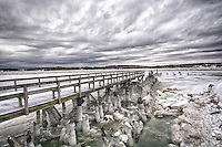SNOW - ICE - COLD. Winter ice flows along the pier at Herring River in Scituate, Massachusetts.