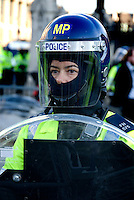 Female riot policewoman policing an student protest London