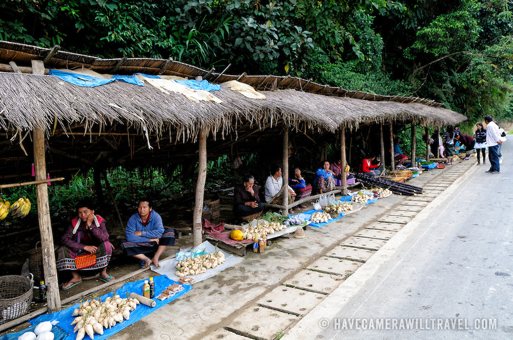 A roadside market where vendors sell food and other items in Luang Namtha province in northern Laos.
