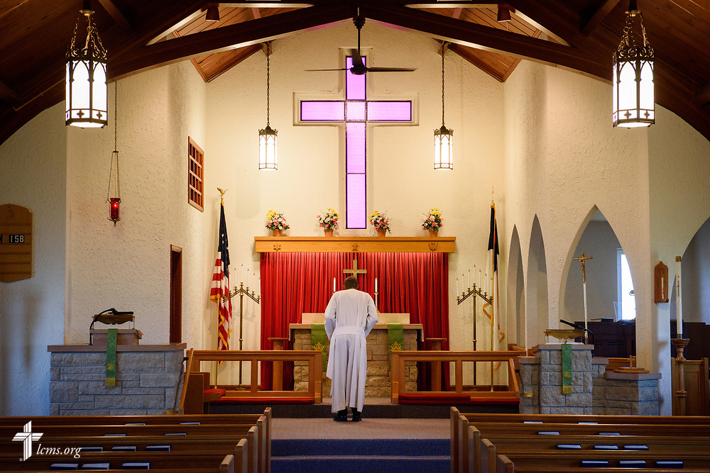 The Rev. Steven Struecker, full-time farmer and pastor of <br /> Immanuel Lutheran Church, Livermore, Iowa, and Zion Evangelical Lutheran Church, Lu Verne, Iowa, bows at the altar at the church in Livermore on Sunday, July 9, 2017. LCMS Communications/Erik M. Lunsford