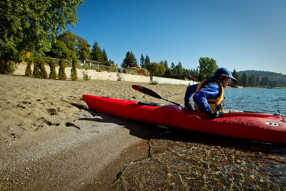 John Mathys launches a kayak Wednesday from the public section of Sanders Beach.