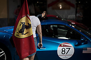 Michael and Marissa from USA getting in the car in the Saint Vincent city center. The Ferrari Cavalcade is an event reserved for the best customers of the Maranello factory. In this 7th edition, the Mont Blanc was chosen. 110 Ferrari, coming from 30 different countries, have covered more than 1000 km between Italy, France and Switzerland.
