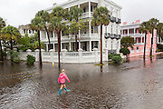A college student walks through floodwater along the Battery in the historic district as Hurricane Joaquin brings heavy rain, flooding and strong winds as it passes offshore October 4, 2015 in Charleston, South Carolina.