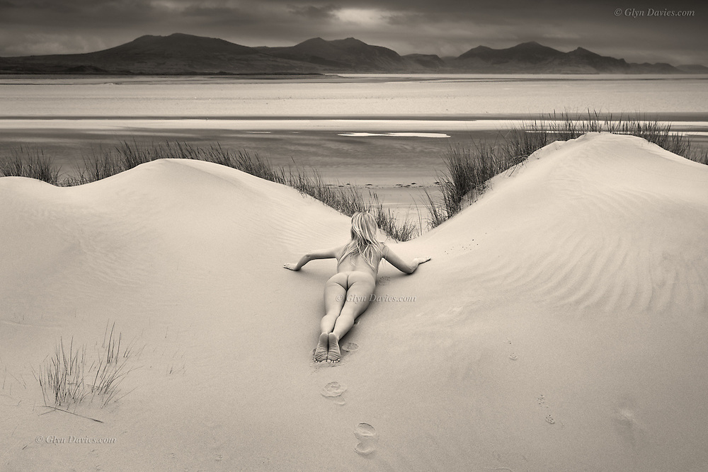 """She wanted to see 'them', on the other side of the dunes. She silently, delicately stooped forward, then lay on her belly so that she'd not be seen, but so that she could secretly observe. Her little footprints would betray that she'd been there watching, but alongside her lay the footprints of a stealthy fox, now almost obscured by wind-blown sand, as hers would be too."""