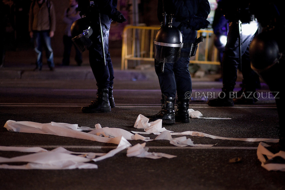 Toilet lays on the ground ext to riot police during a demonstration against political corruption and claiming Mariano Rajoy to resign outside the PP headquarters in Madrid on February 1, 2013. The Spanish Newspaper 'El Pais' published secret papers of income implicating Spanish Prime Minister and other members of the PP (Popular Party). Rajoy's government has denied these secret payments.