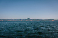 ANGUILLARA SABAZIA (LAKE BRACCIANO), ITALY - 26 JULY 2017: A view of Lake Bracciano whose level has dropped more than 1,50 meters recently, from Anguillara Sabazia (Lake Bracciano), Italy, on July 26th 2017.<br /> <br /> Lake Bracciano provides eight percent of Rome's water and has sunk about 1.5 meters<br /> <br /> A severe drought and sweltering temperatures have led Rome city officials to consider a potential rationing of drinking water for eight hours a day for a million and a half Rome residents. The water crisis has become yet another sign of man being at the mercy of an increasingly extreme climate, but also of once mighty Rome's political impotence, managerial ineptitude and overall decline.