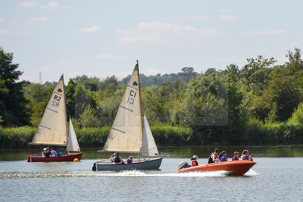 © Licensed to London News Pictures. 23/07/2018. LONDON, UK. Children receive sailing lessons during hot weather at Rickmansworth Aquadrome in north west London, on a day when temperatures reached 30C.  Temperatures up to 35C are forecast for the rest of the week during the current heatwave.  Photo credit: Stephen Chung/LNP