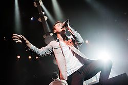 © Licensed to London News Pictures. 30/11/2012. London, UK.   Tom Chaplin of Keane performing live at The O2 Arena. Keane are an English alternative rock band from Battle, East Sussex, formed in 1997. The group currently comprises Tim Rice-Oxley (piano, synthesisers, backing vocals), Richard Hughes (drums, percussion, backing vocals), Jesse Quin (bass guitar, electric guitar, backing vocals) and Tom Chaplin (lead vocals, acoustic guitar).   Photo credit : Richard Isaac/LNP