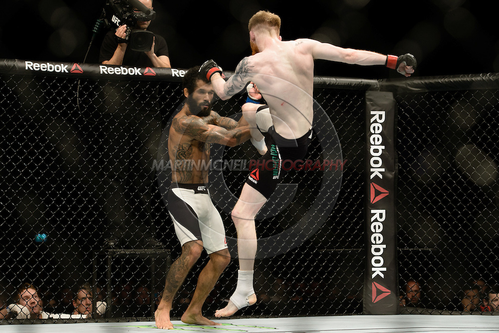 GLASGOW, SCOTLAND, JULY 18, 2015: Patrick Holohan (black trunks with white stripe) defeats Vaughan Lee by judge's decision during UFC Fight Night 72 inside the SSE Hydro Arena in Glasgow. (Martin McNeil for ESPN)