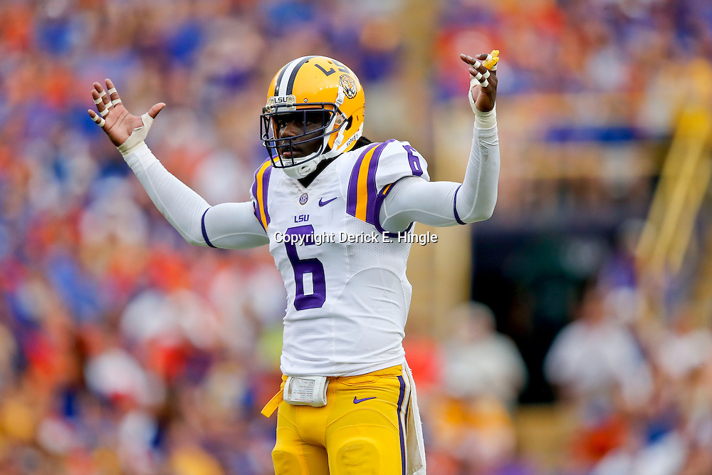 Oct 12, 2013; Baton Rouge, LA, USA; LSU Tigers safety Craig Loston (6) pumps up the crowd against the Florida Gators during the second half of a game at Tiger Stadium. LSU defeated Florida 17-6. Mandatory Credit: Derick E. Hingle-USA TODAY Sports
