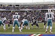 Bills quarterback Drew Bledsoe motions to his teammates during a 20 to 3 win by the Miami Dolphins over the Buffalo Bills in an NFL Week 16 game in Buffalo on December 21, 2003. Drew was sacked six times while completing only 12 of 24 passes with one interception and no touchdowns. ©Paul Anthony Spinelli