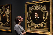 UNITED KINGDOM, London: 27 February 2018 A visitor takes a close look at Bartolomé Esteban Murillo's 'Portrait of Juan Arias de Saavedra' (1650, left) and 'Portrait of Count Diego Ortiz de Zúñiga' (about 1655, right) at the new exhibition entitled 'Murillo: The Self Portraits' at The National Gallery in London this morning. <br /> The exhibition marks the 400th anniversary of one of the most celebrated Spanish artists. <br /> Rick Findler  / Story Picture Agency