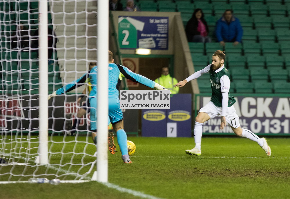 Queen of the South's Robbie Thomson gets ready for the shot by Hibernian's Martin Boyle in the Hibernian vs Queen of the South Scottish Championship 19th December 2015......(c) MARK INGRAM | SportPix.org.uk