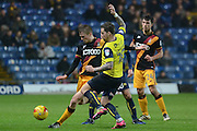 Bradford City defender Stephen Darby (2) clears from Oxford United striker Chris Maguire (10) 2-0 during the EFL Trophy match between Oxford United and Bradford City at the Kassam Stadium, Oxford, England on 31 January 2017. Photo by Alan Franklin.